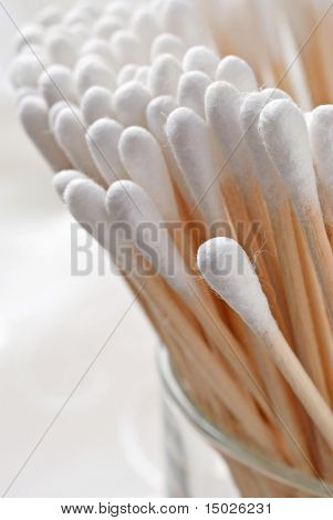 Soft focus image of cotton-tipped swabs.  Macro with extremely shallow dof.  Selective focus on closest tip.