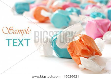 Colorful salt water taffy on white background with copy space.  Macro with extremely shallow dof.