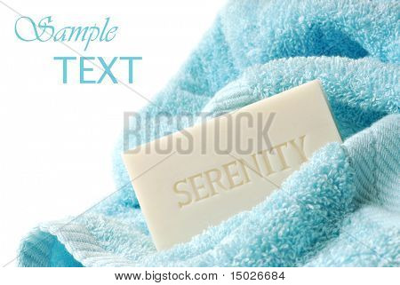 Embossed soap with bath towel on white background with copy space.  Macro with shallow dof.