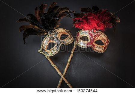 amazing beautiful closeup view of theatrical colorful masks on dark grey background