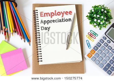 employee appreciation day text message on white paper and office supplies, pen, paper note, on white desk , copy space / business concept / view from above, top view