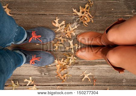 Couple Man and Woman Feet in Love Romantic Outdoor with Autumn leaves