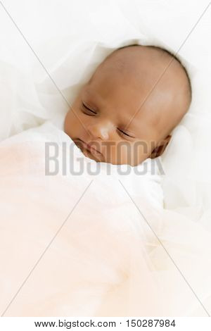 Three weeks old baby sleeping on white blanket cute infant newborn lying down close up shot eyes closed
