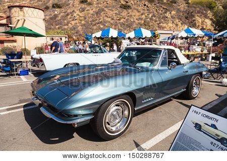 Laguna Beach, CA, USA - October 2, 2016: Blue 1967 Chevy Stingray owned by Alexander Vracin and displayed at the Rotary Club of Laguna Beach 2016 Classic Car Show. Editorial use.