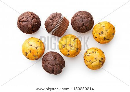 The tasty muffins with chocolate isolated on white background.