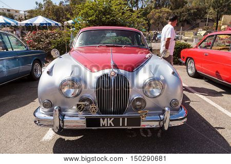 Laguna Beach, CA, USA - October 2, 2016: Red classic Jaguar 3.8 GB displayed at the Rotary Club of Laguna Beach 2016 Classic Car Show. Editorial use.