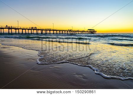 Henley Beach Jetty with people on a warm sunny evening.