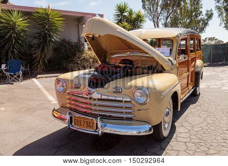 Laguna Beach, CA, USA - October 2, 2016: Tan and wood 1946 Ford Woody owned by George Nelson and displayed at the Rotary Club of Laguna Beach 2016 Classic Car Show. Editorial use.
