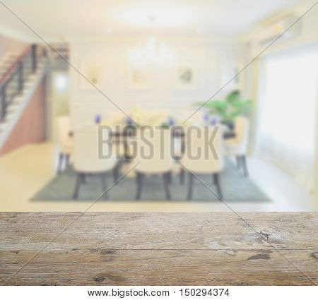 wooden table top with blur of classic style dining table in the dining room