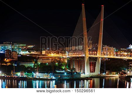Night view of the bridge in the Russian Vladivostok over the Golden Horn bay