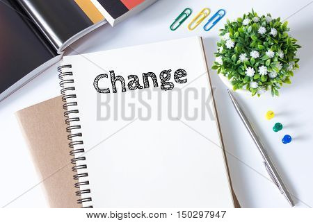 Change, Text message on white paper book on white desk / business concept