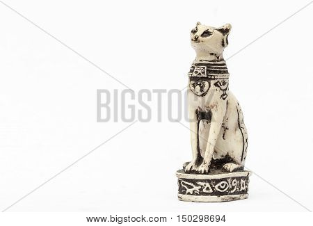 Statuette of the Egyptian cat close up on a white background.
