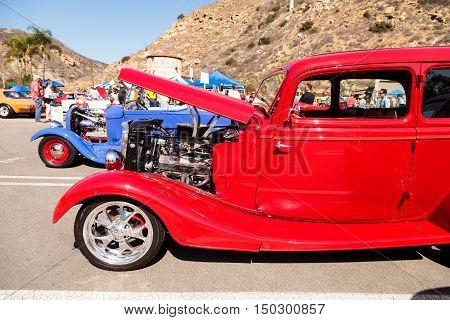 Laguna Beach, CA, USA - October 2, 2016: Red 1933 Ford 40 sedan owned by Jeffrey Counseller and displayed at the Rotary Club of Laguna Beach 2016 Classic Car Show. Editorial use.