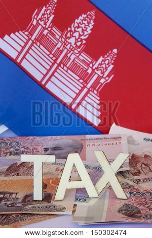Taxation signage with Cambodian cash and the flag.
