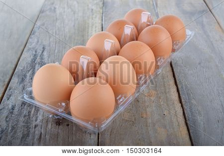 eggs in transparent tray package on wooden table