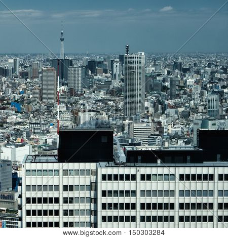 Tokyo - June 2016: Elevated city view in sunny day. Shinjuku