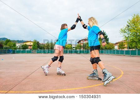 Two Sports Girl In A Tennis Rollerblade Give You Clap Their Hands