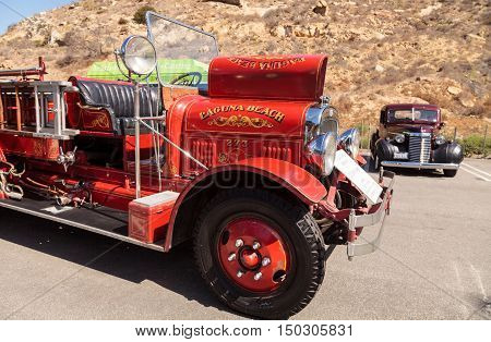 Laguna Beach, CA, USA - October 2, 2016: Red 1931 Seagrave Suburbanite 500 GPM Pumper fire engine owned by the city of Laguna Beach and displayed at the Rotary Club of Laguna Beach 2016 Classic Car Show. Editorial use.