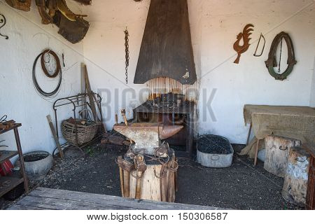 Vintage Room blacksmith forging metal. Construction of the blacksmith's life.