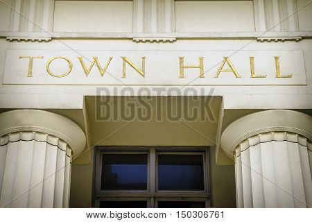 Grand town hall sign and entrance with columns