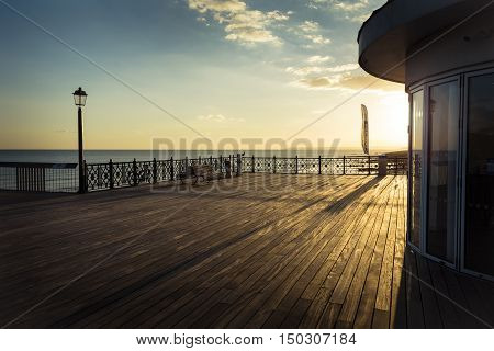 New Hastings pier and horizon in golden sunlight
