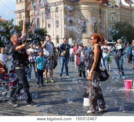 Prague Czech Republic - September 23 2016 - unidentified people having fun with soap bubbles on Old Town Square.