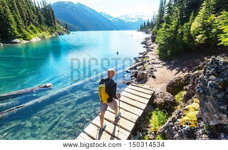 Hiking man in Canadian mountains. Hike is the popular recreation activity in North America. There are a lot of picturesque trails. poster