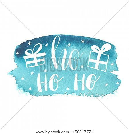 Blue Greeting Christmas card with hand-drawn typography lettering phrase HoHoHo and present boxes on waterccolor painted background. Holiday banner or poster design. Ho-Ho-Ho