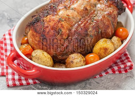 Boneless Pork Loin Roast with Potatoes and Tomatoes