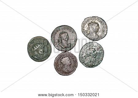 Many ancient bronze coins on over  white