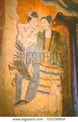 NAN THAILAND - 2016 Sep 30 :The famous mural painting of a man whispering to the ear of a woman. at Wat Phumin a famous temple in Nan province Thailand.