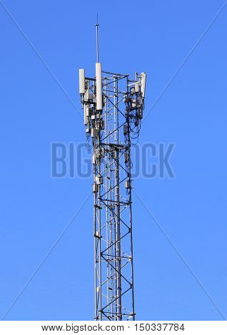 silver colored cell phone tower with antenna, south of Songkhla, Thailand