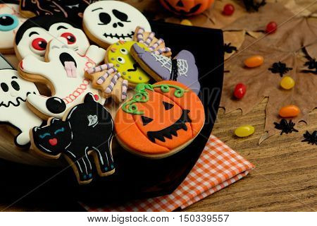 Creepy Halloween cookies and candies on a wooden table