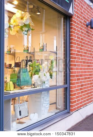 glass storefront shopping bags over a brick wall background