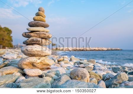 Pile of balancing stones on a pebble beach in Platamonas. Pieria Central Macedonia Greece Europe