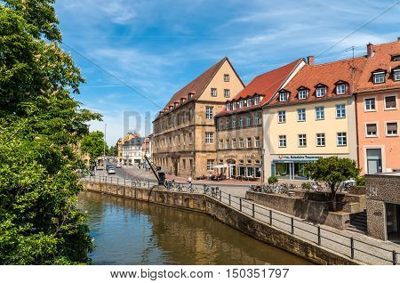 Bamberg Germany - May 22 2016: Scenic spring view with flowering chestnut tree of the Old Town pier architecture in Bamberg Bavaria Germany