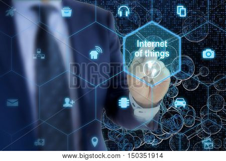 IT expert touches hexagon grid with IOT symbols on a digital letter glass spheres network background