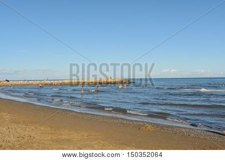 People enjoy the beach holiday on the Adriatic - beach and sea Italy