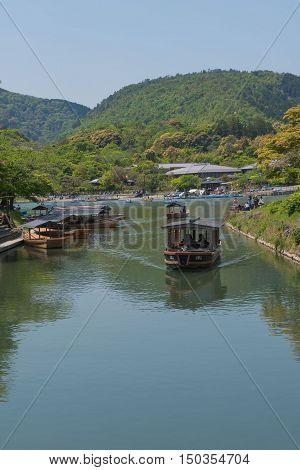 KYOTO, JAPAN - APRIL 30 , 2016: boats in the river at Arashiyama, Kyoto, Japan. Arashiyama  , Scenic Beauty and Historic .  Kyoto, Japan. APRIL 29 2016.
