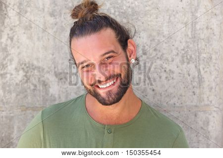 Smiling Man With Ponytail And Beard