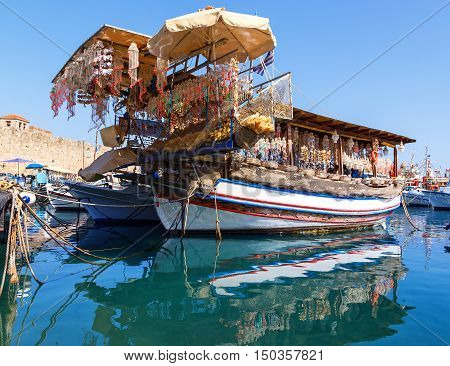 Seashells shop boat in harbour of Rhodes, Dodecanese, Greece