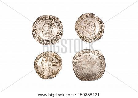 Many ancient silver coins on over white