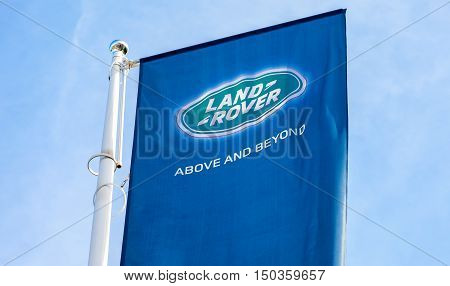 SAMARA RUSSIA - AUGUST 27 2016: Official dealership flags of Land Rover against the blue sky background. Brand of the British multinational car manufacturer Jaguar Land Rover owned by Tata Motors