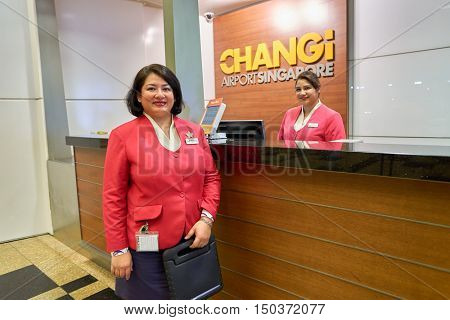 SINGAPORE - CIRCA AUGUST, 2016: portrait of a airport staff at information desk in Singapore Changi Airport. Changi Airport, is the primary civilian airport for Singapore.