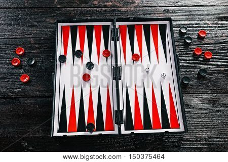 Board and pieces for the backgammon. Flat lay