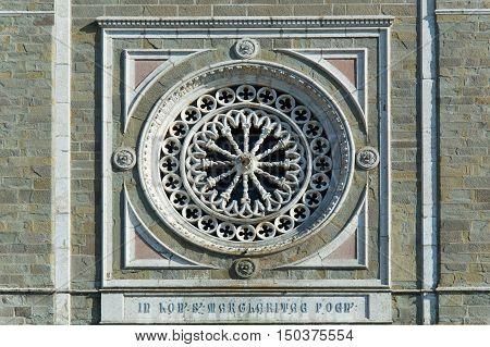 Rose window of Santa Maria church in Cortona Tuscany Italy closeup