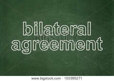 Insurance concept: text Bilateral Agreement on Green chalkboard background