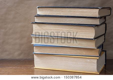 stack of well read books against blurred background