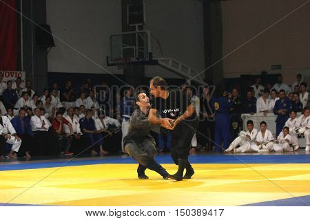 BELGRADE,SERBIA - SEPTEMBER 24 2016: Fighters demonstrate actions at martial arts evening