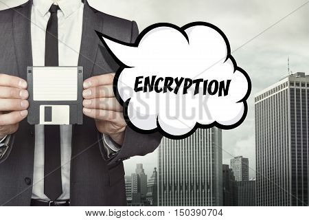 Encryption text on speech bubble with businessman holding diskette